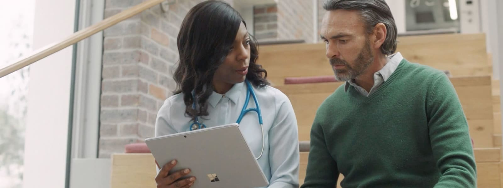 medical provider reviewing information on a tablet with patient