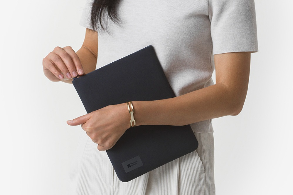 Person holding Surface Go Sleeve