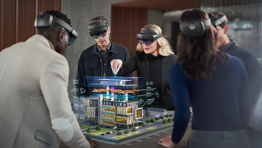 5 people wearing virtual reality headsets examining and interacting with an architectural model of a building