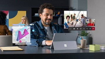 A man at a desk works with a remote team using Microsoft Teams