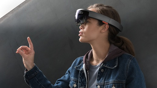 Woman wearing a virtual reality headset making hand motions