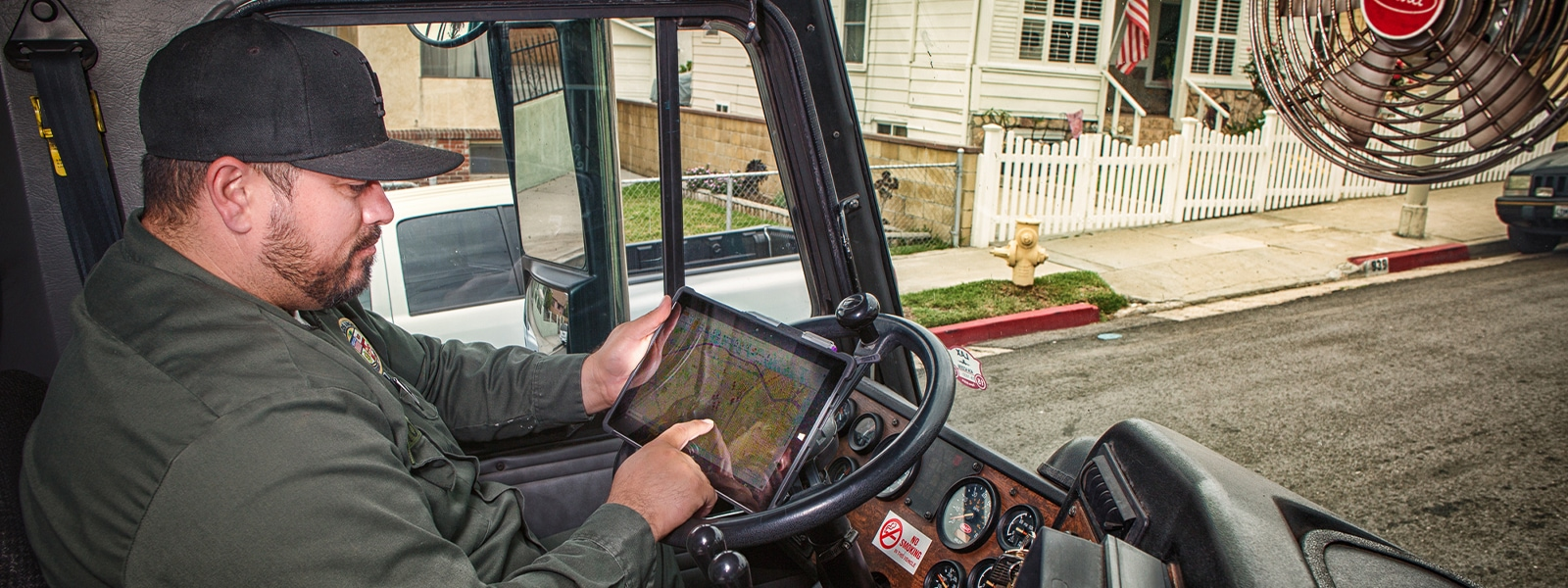 Driver using a tablet inside a vehicle