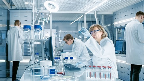 group of medical professionals in a laboratory setting
