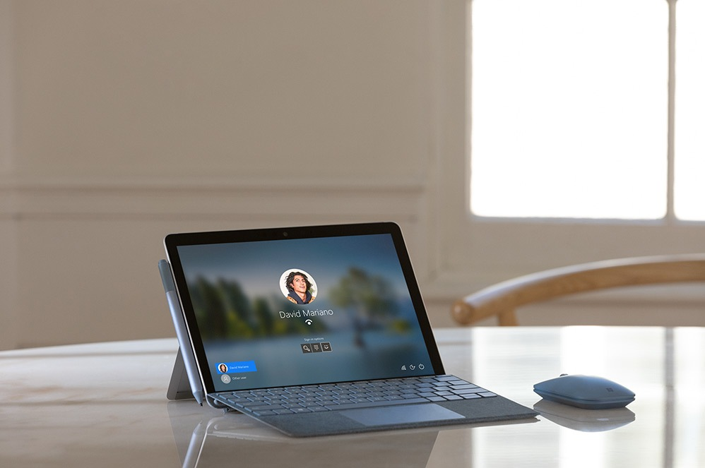 A Surface Go 2 in Laptop Mode with Surface Go Signature Type Cover and Surface Mobile Mouse
