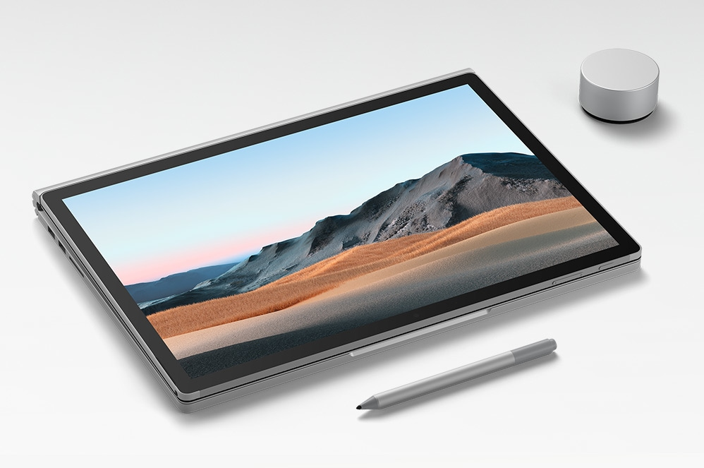 Surface Book 3 i studioläge med Surface-penna och Surface Dial
