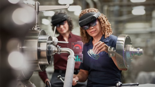 Two people working with HoloLens Devices