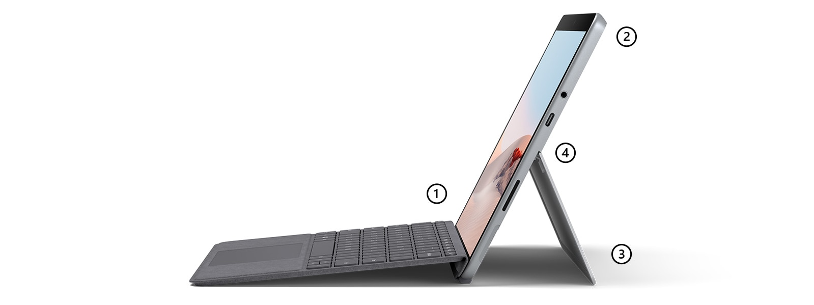 Surface Go 2 in Laptop Mode with Surface Go Signature Type Cover in Platinum with points highlighting the pen-enabled touchscreen, Microphones and camera, kickstand, and USB-C port