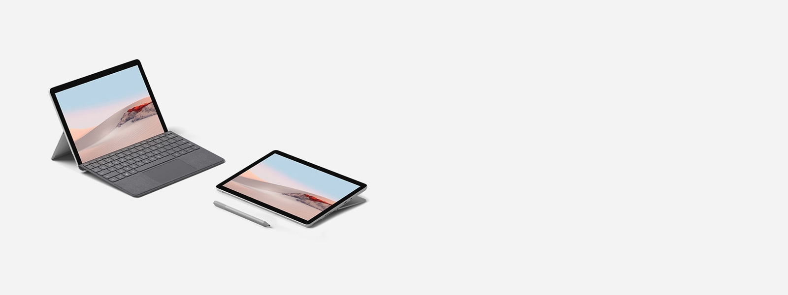 Surface Go 2 im Laptop-Modus mit Surface Go Signature Type Cover in Platin und im Studio-Modus mit Surface Pen