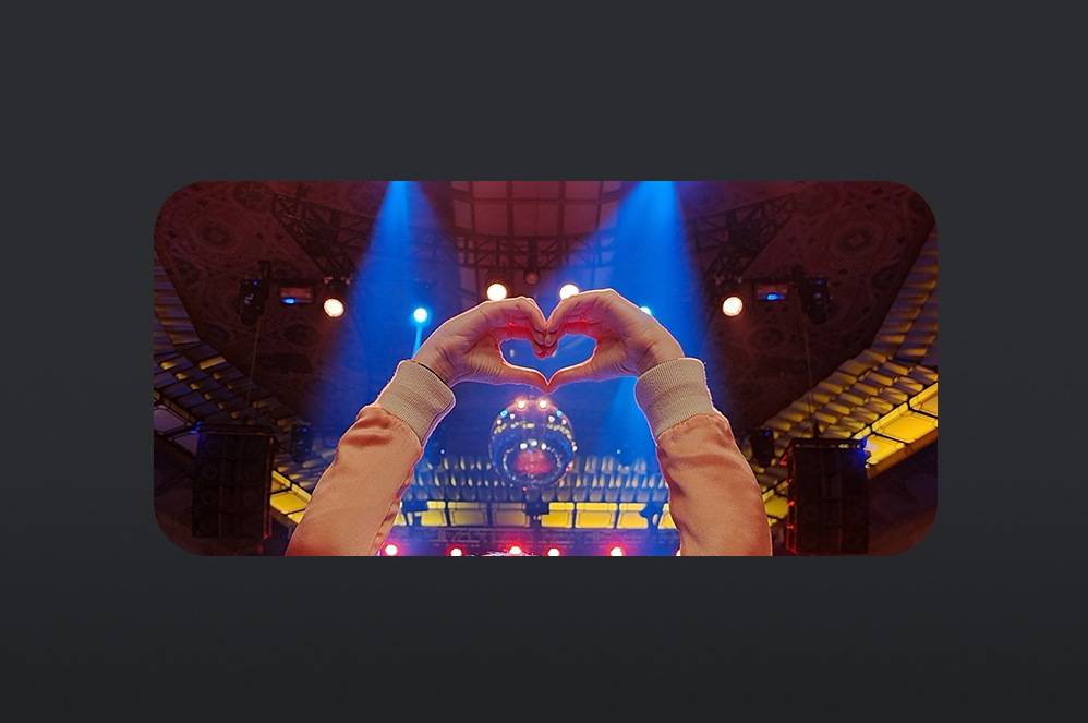 Phone screen of picture of heart hands in a heart shape at a concert