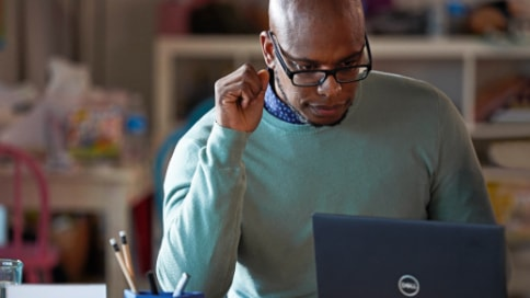 Person wearing glasses using a laptop