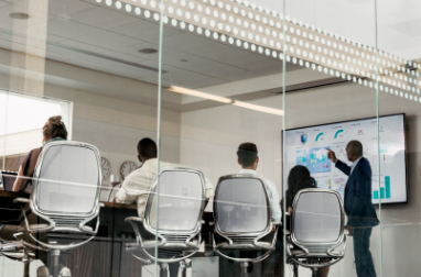 People watching a presentation in a large conference room
