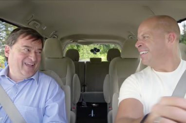 Two people in a vehicle laughing