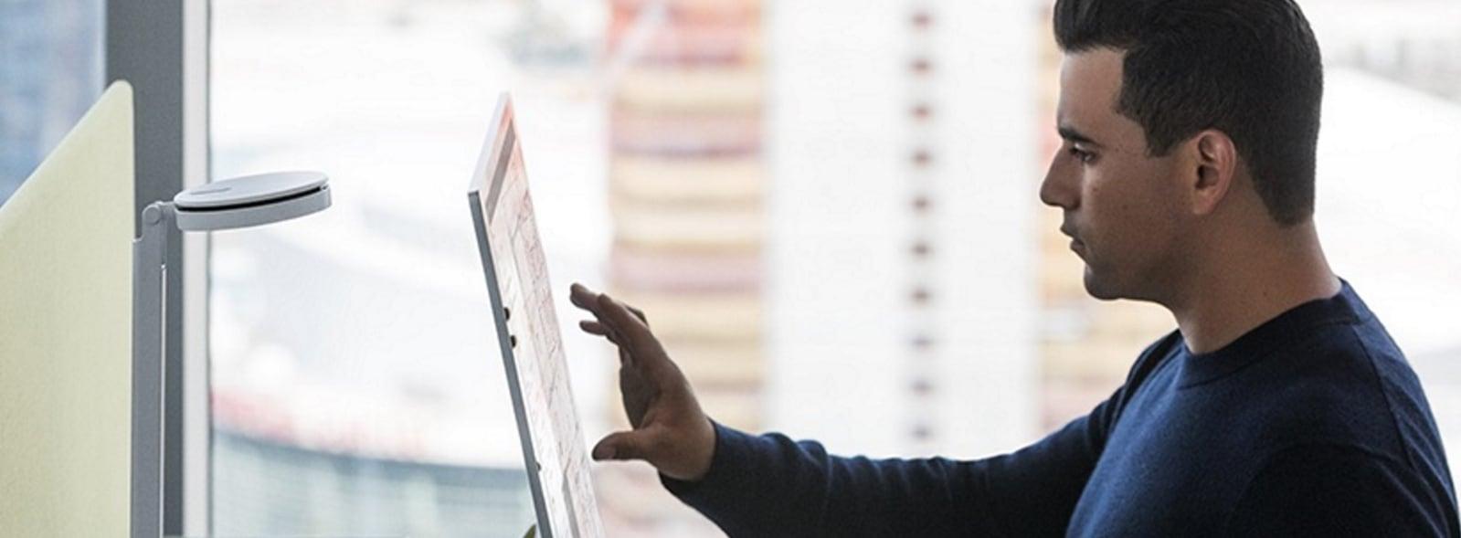 Man touching computer screen.