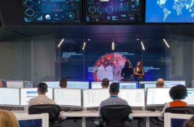 Inside the Microsoft Cyber Defense Operations Center with many people working at desks with monitors