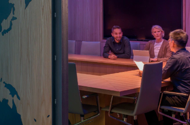 Three people meeting in a conference room