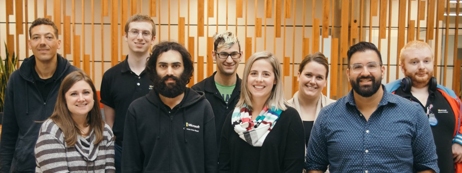 A small group of diverse people in the Supported Employment Program at Microsoft, smiling.