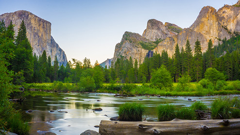 Nature setting of mountains, trees, lakes, and rocks