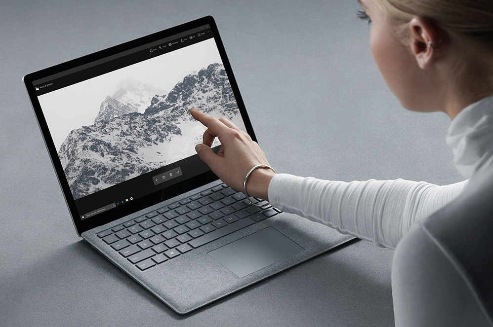 Woman using touchscreen of Surface Laptop
