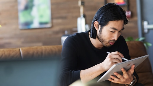 Man working from home on his Surface Pro