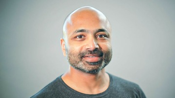 Keshav Puttaswamy smiles at the camera.