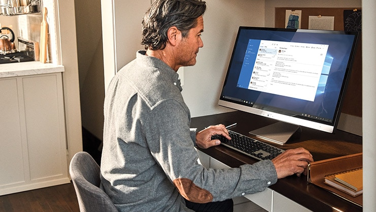 Man interacting with an Asus Viv0Book desktop.