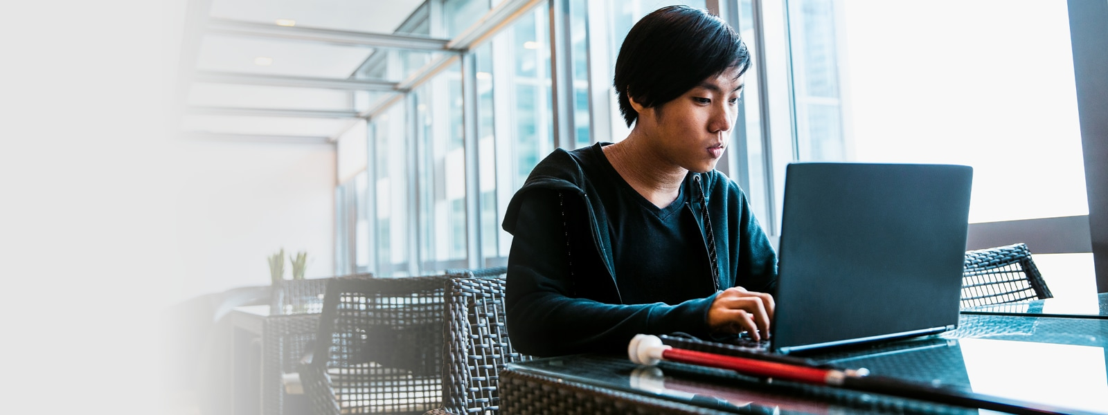 Joshua, a tech worker with visual impairment, uses assistive technology while visiting the Microsoft office in Singapore.