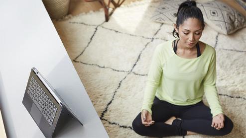 Woman sitting cross-legged meditating