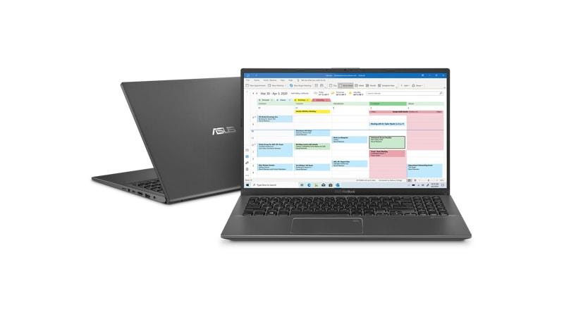 Dos computadoras portátiles Asus Vivobook 15, una hacia el frente con Outlook en la pantalla y la otra ligeramente cerrada desde la parte posterior