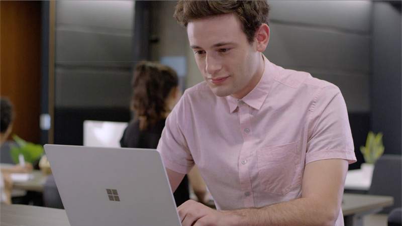 A new employee searches for information on his laptop