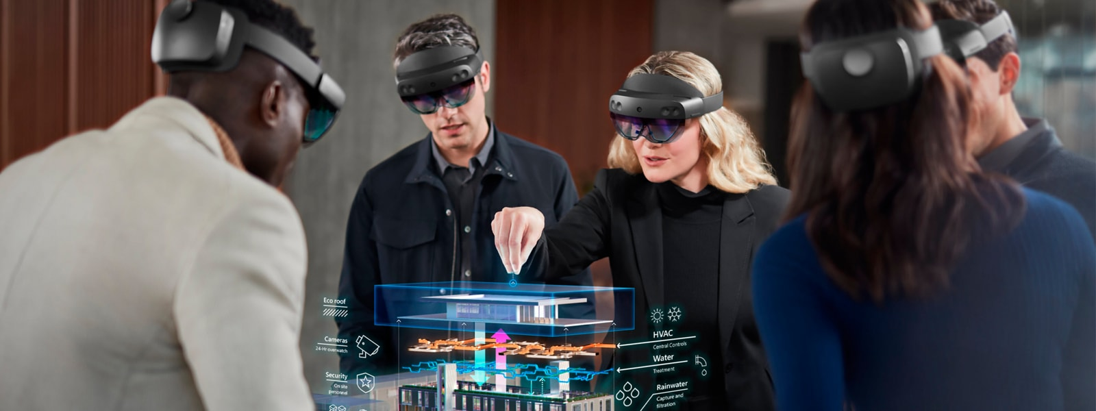 Group of business professionals wearing Microsoft HoloLens to view building in 3D.