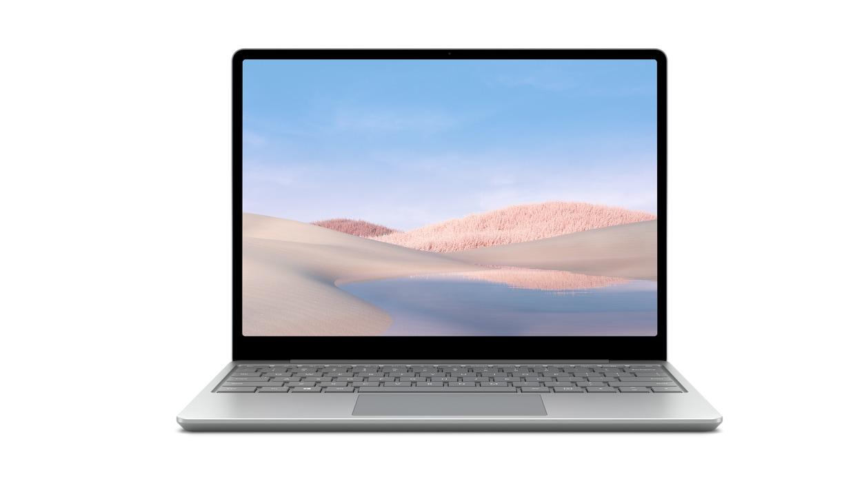 A platinum Surface Laptop Go sits open against a white backdrop.
