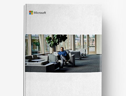 Image of a book with the Microsoft logo on the top left corner and a photograph of a person sitting in an armchair working on a laptop.