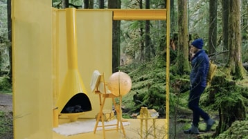 A person using a campground in a forest.