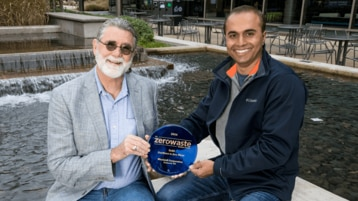 Mark Freeman, Microsoft Dining Services, and Mohan Reddy Guttapalem, Senior Facilities Manager, holding a gold level Zero Waste Certification award