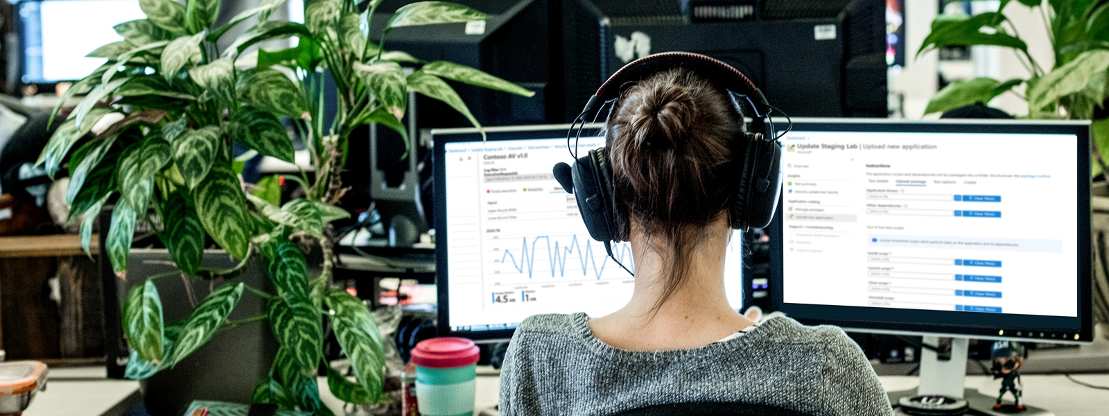 A woman with a headset sitting at her desk in a modern office setting