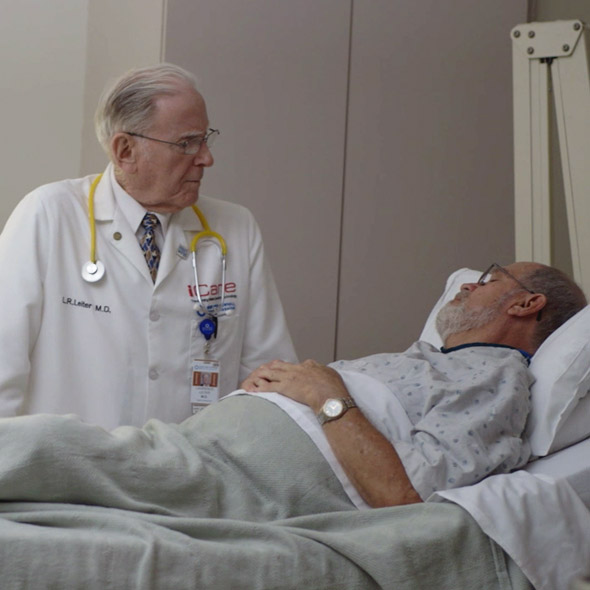 Doctor working with patient in hospital.