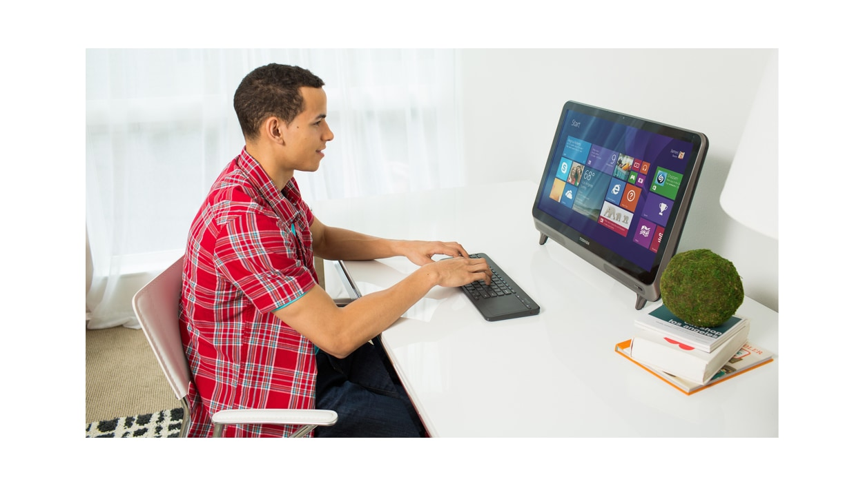 Microsoft All-in-One Media Keyboard at desk with PC