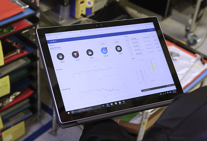 Tablet with Jabil dashboard.
