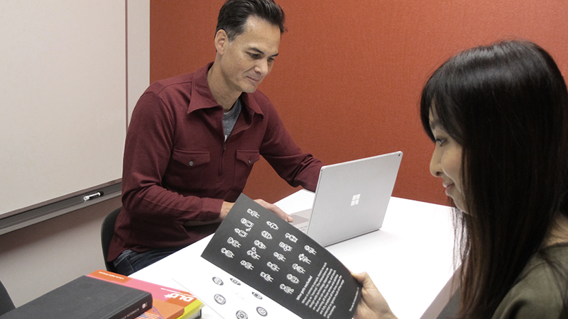 A man and a woman collaborate using the inclusive design manual.