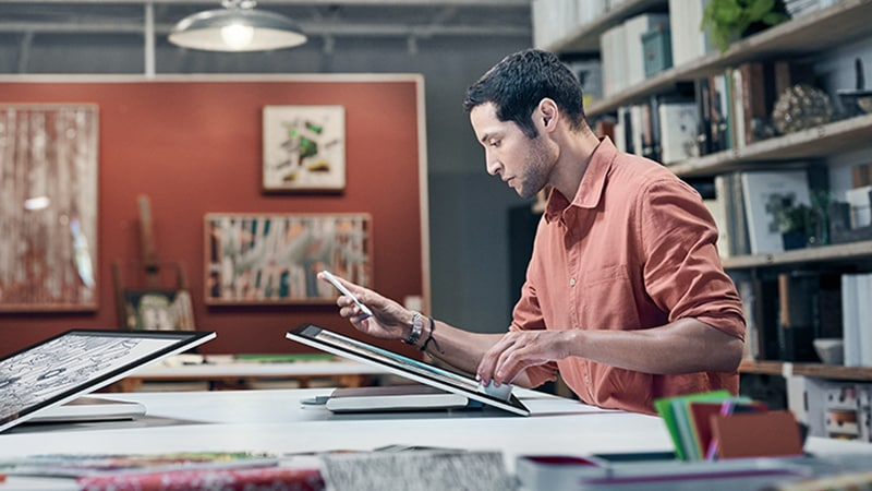 Man Using Surface Dial in Office