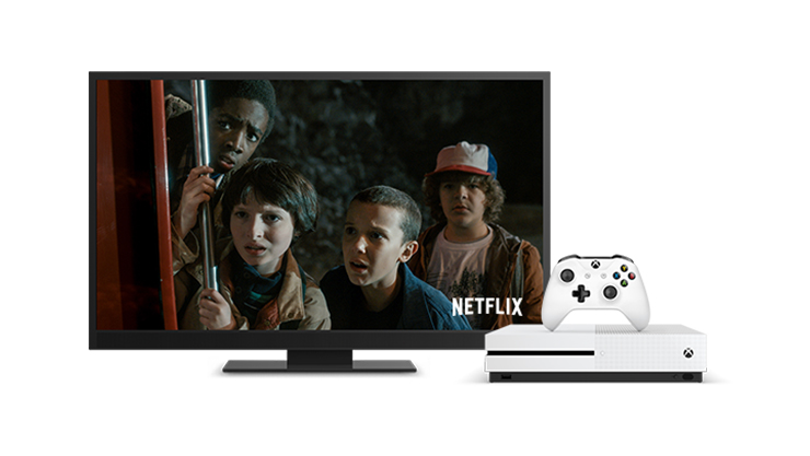 Xbox One S console with controller and a monitor with Netflix