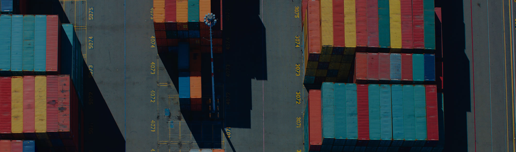 Aerial view of shipyard showing shipping containers.