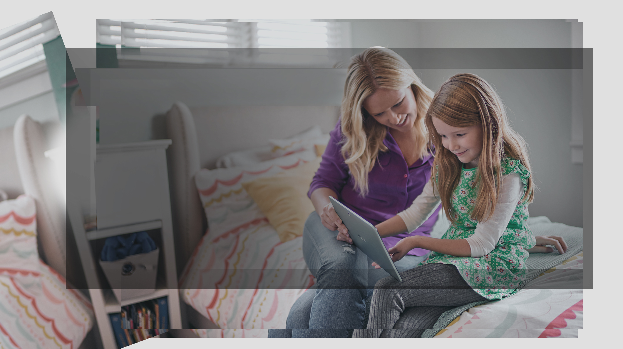 A mother and daughter look at a PC screen