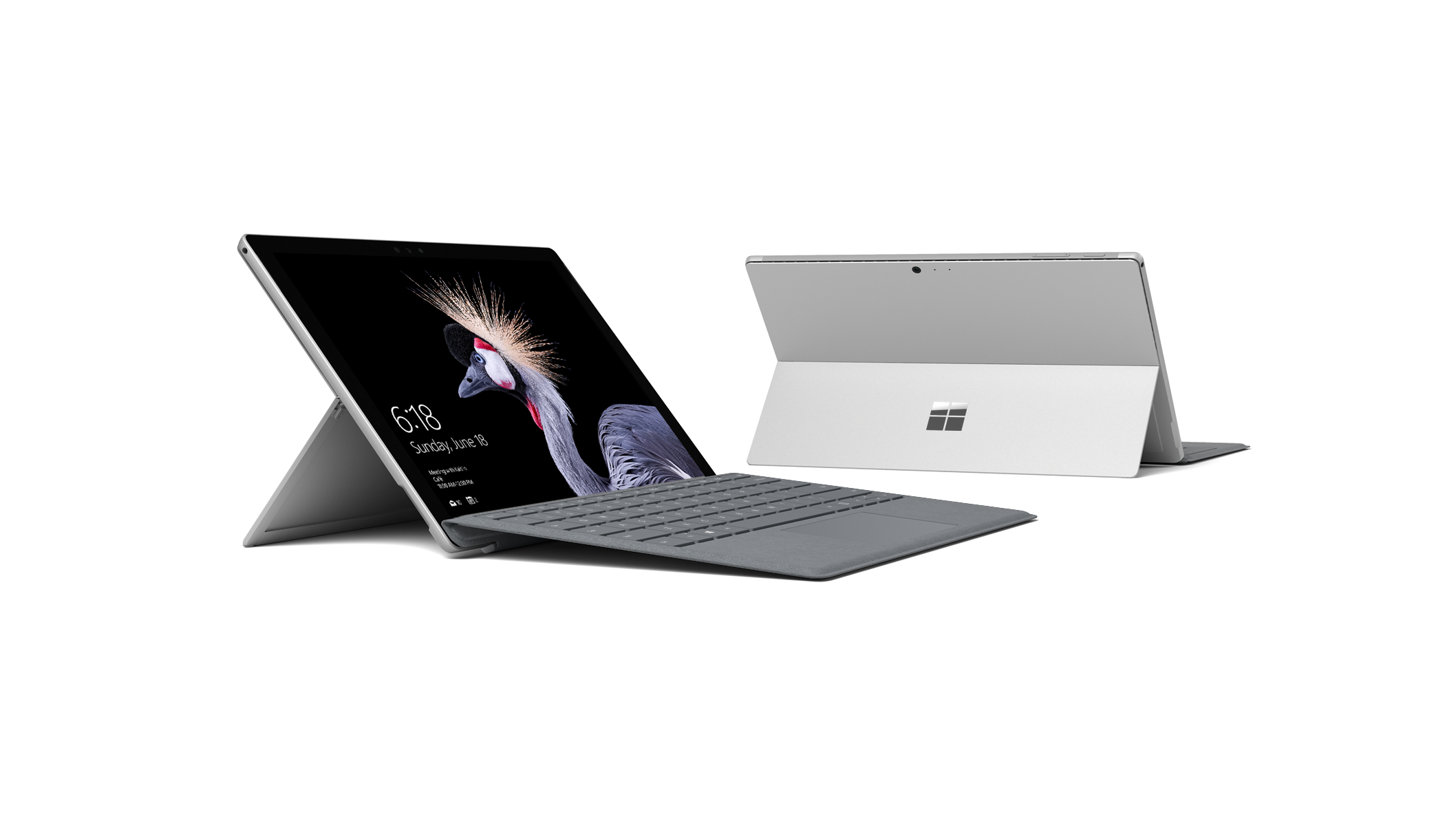 Dos dispositivos Surface Pro, uno con cubierta tipo sujeta, el otro mostrado desde atrás con soporte extendido