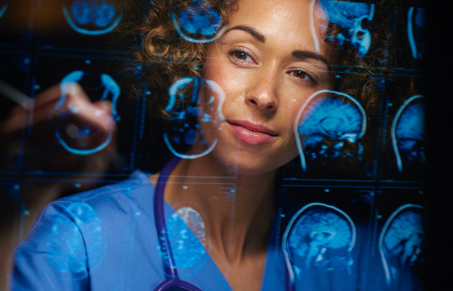 A healthcare professional looking at body scans.