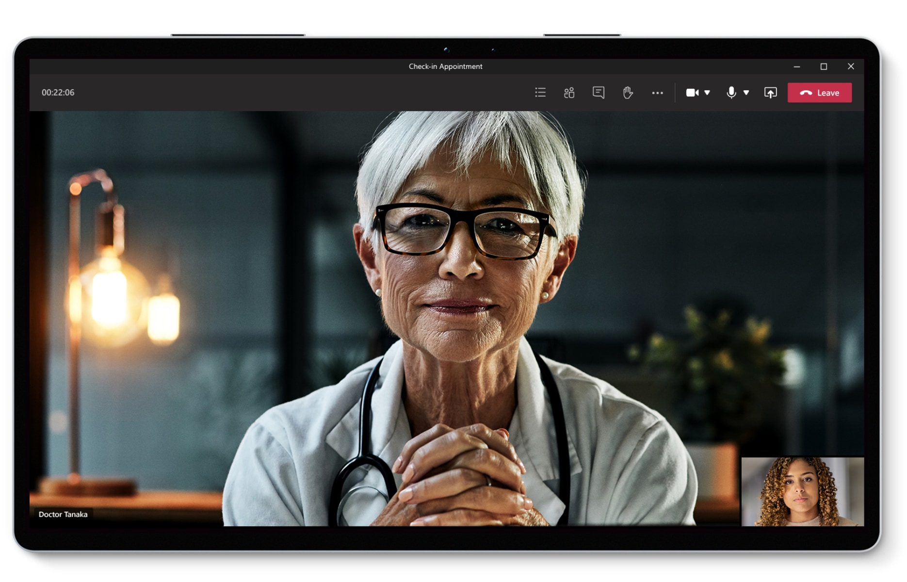 A healthcare professional and a patient having a virtual visit over Teams.