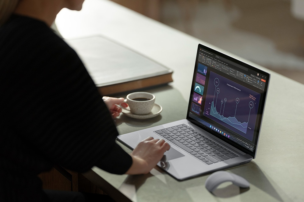 A person interacts with the trackpad on their Surface device