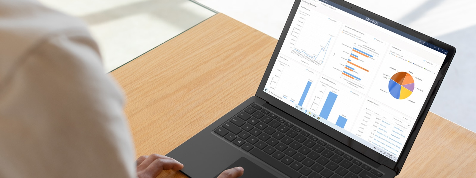 Close up of a Microsoft laptop using the Fundraising and Engagement solution