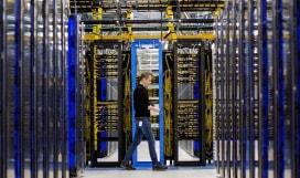 A person walking through a datacenter