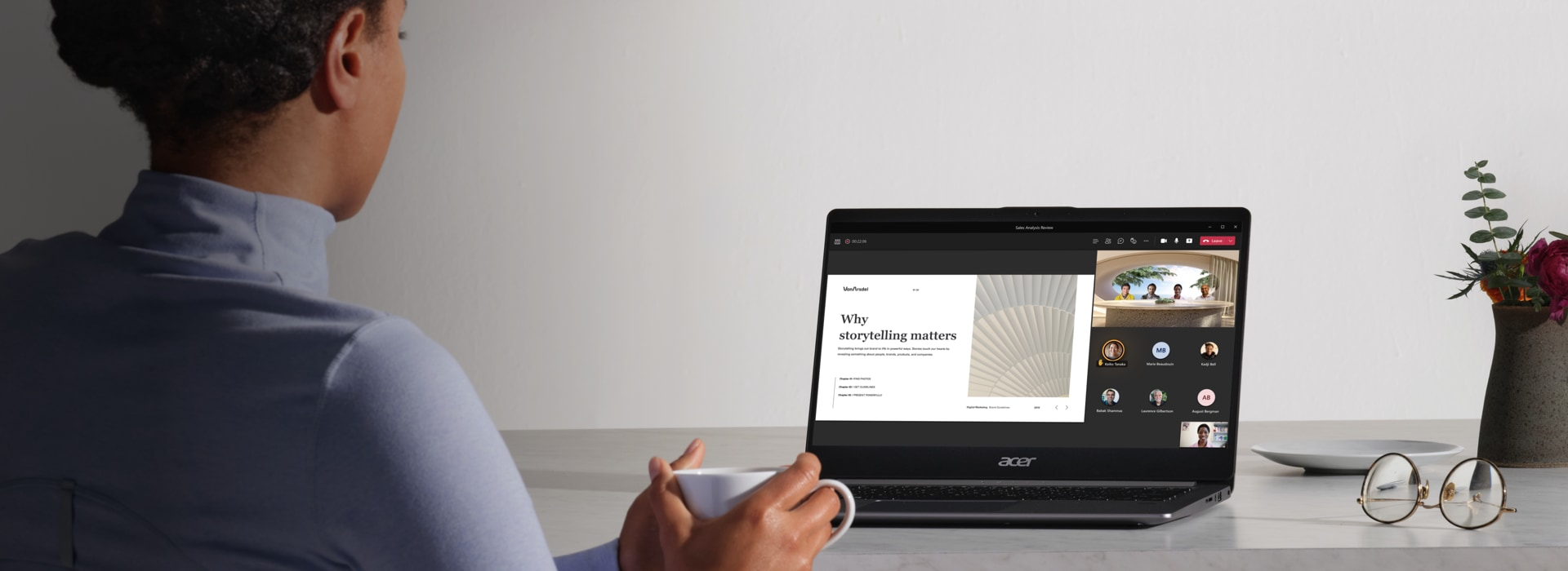 A person using a laptop to participate in a Teams call that is using Together mode and a presentation is being given.